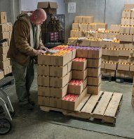 A driver checking out one of his drinkable yogurt orders. In the winter, when it's cold, the drivers fulfill their orders themselves in the warehouse.