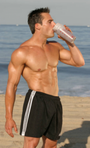 man drinking creatine